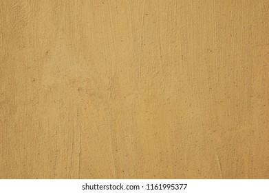 yellow plastered painted wall