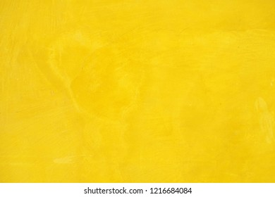 Yellow plastered wall texture grunge background