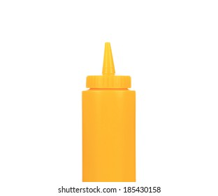 Yellow plastic container for sauce. Isolated on a white background.