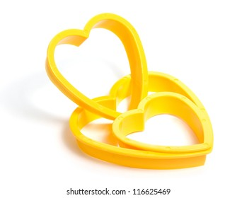 Yellow plastic cookies cutter isolated on white