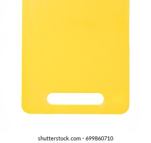 yellow plastic cutting board isolated on white background