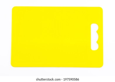 Yellow plastic cutting board on isolated white background