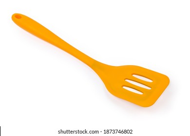 Yellow plastic kitchen spatula with bendable working part used to mix, lift and flip food during cooking for non stick pans on a white background