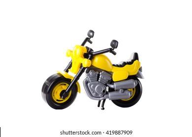 Yellow plastic motorbike toy isolated on white background