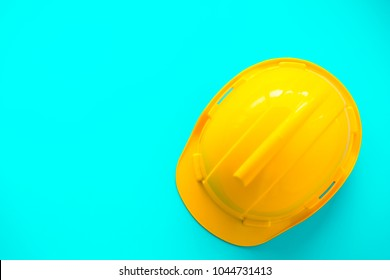 yellow plastic safety helmet on blue background