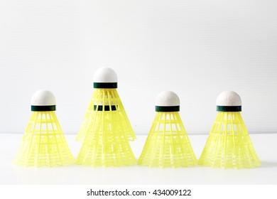 yellow plastic shuttlecocks