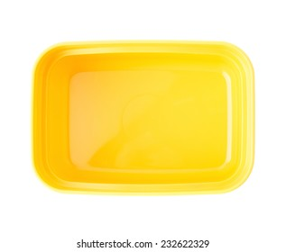 Yellow plastic tableware food container isolated over the white background