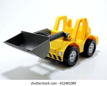 Yellow Plastic Toy Bulldozer  on White Background