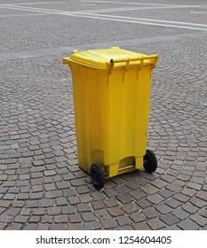 Yellow Plastic Wheelie Bin at City  Square