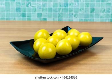 Yellow plums in flat black