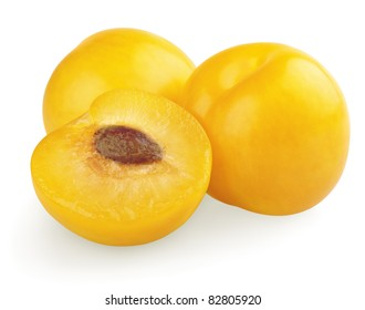 Yellow plums with half isolated on white background