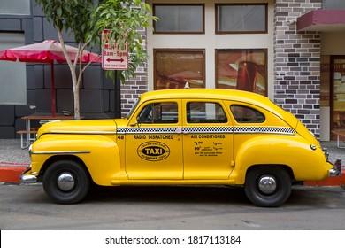 Yellow Plymouth De Luxe classic car at museum angkut - Batu, Malang 12 September 2020