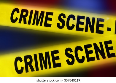 yellow police crime scene tape on red and blue background