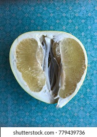 Yellow pomelo on blue background