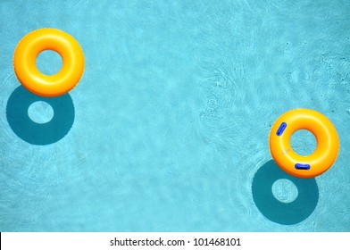 Yellow pool float, pool ring in cool blue refreshing blue pool, room for your text