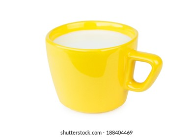 Yellow porcelain cup with milk isolated on white background
