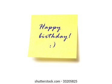 """Yellow post it with words """"Happy birthday!"""" isolated on white"""