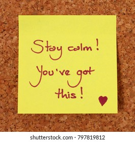Yellow Post-It Note on a Cork Board Background, Saying Stay Calm, You've Got This.