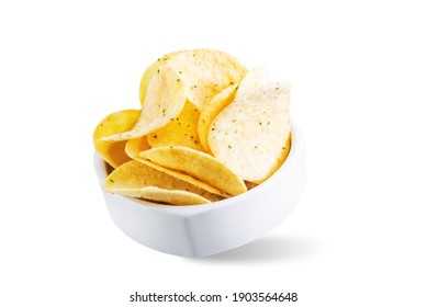 Yellow potato chips with salt and season on a white isolated background. toning. selective focus