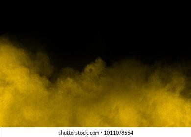 Yellow powder explosion isolated on black background