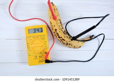 A yellow power meter measures the generated electricity from a banana in a school trial