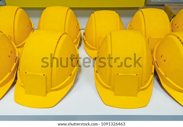 yellow-protecting-hard-hats-on-600w-1091