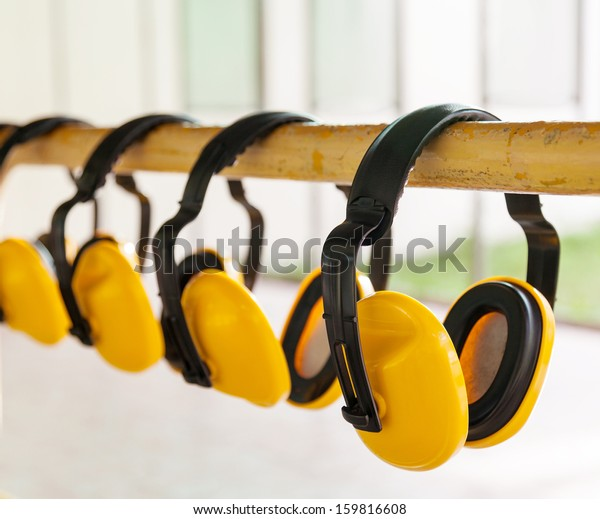 The yellow protective earmuffs for shooting .