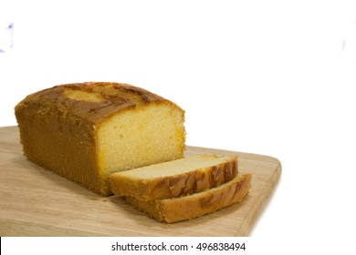 Yellow pumpkin loft pound cake on brown wooden tray - copy space with white background