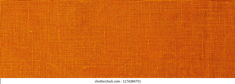 Yellow pure linen fabric background. Natural linen texture, banner
