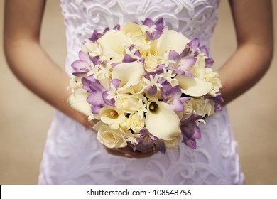yellow and purple bride's bouquet
