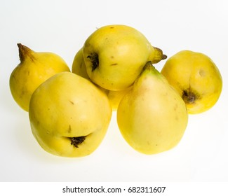 Yellow Quince fruit isolated on white
