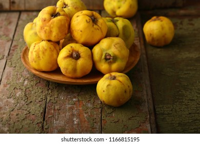 Yellow quince fruits on plate