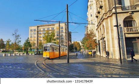 Yellow rail tram of the city of Budapest in Hungary. Tram line number 2 voted the best scenic european route. Blurred unrecognizable faces of people. Budapest transport.