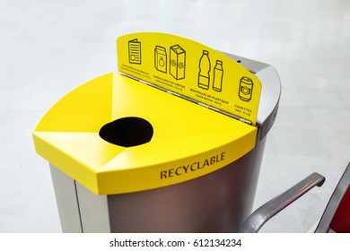 Yellow recycling waste bin indoors