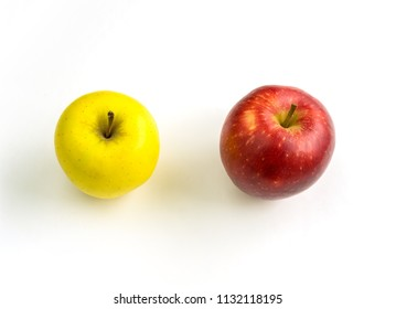 YELLOW AND RED APPLE ON A WHITE BACKGROUND