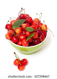 yellow and red cherries in bowl over white