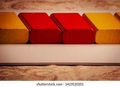 Yellow and red colored bricks crop