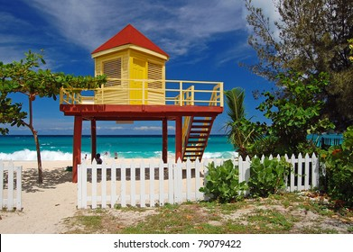 Yellow and red lifeguard booth on Grand Anse Beach on Grenada Island