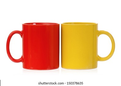 Yellow and red mugs empty blank for coffee or tea isolated on white background