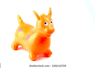 yellow, red, orange colors, plastic, cute, for children, four-legged, eared, tailed, standing on white background, toy animal