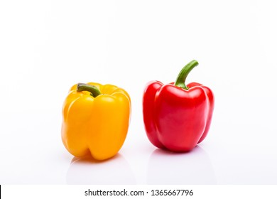 Yellow and red pappers on white background
