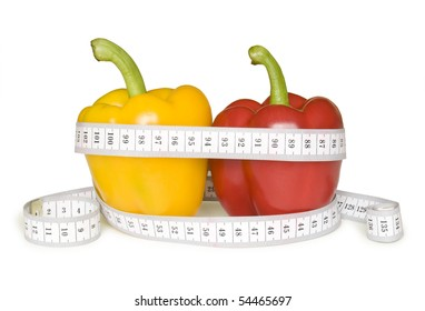 yellow and red paprika and tape measure