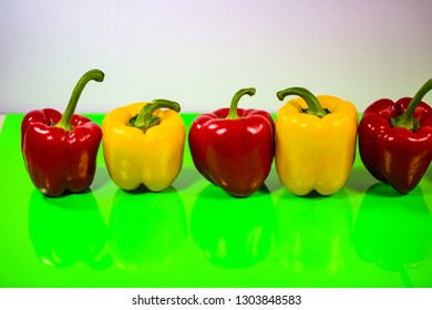 yellow and red peppers in a row