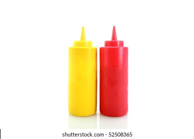 yellow and red plastic ketchup and mustard bottles isolated on white