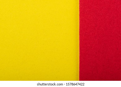 Yellow and red sheet of colored velvet paper. Bright color background. Horizontal orientation. Square and vertical strip. Top view flat lay with copy space.