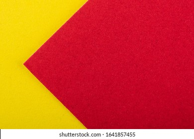 Yellow and red velvet cardboard, colored paper as a bright background with copy space. Diagonal lines, triangular.