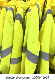 Yellow reflective jackets in a store