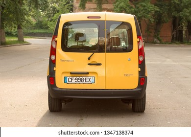 Yellow Renault Kangoo Z.E. electric car at the street