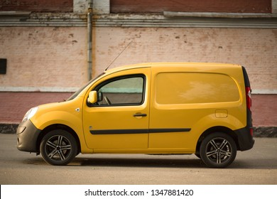 Yellow Renault Kangoo Z.E. electric car at the street