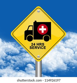 Yellow Rhombus Road Sign For Ambulance Car 24 HRS Service Against The Blue Sky Background